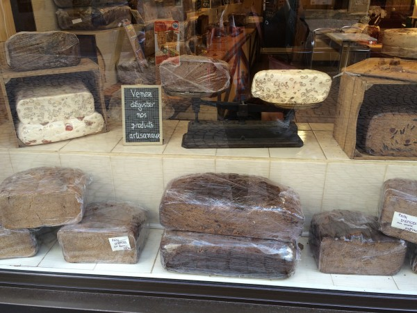 Pain d'Epices, buy the kilo.  The slab I bought, about an inch thick, cost 40 euros.